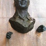 Bronze Man on Water Wall