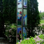 """Peace Pillar Stainless Steel, Laminated coloured glass to tempered glass 10ft x 12""""x12"""" 2013"""
